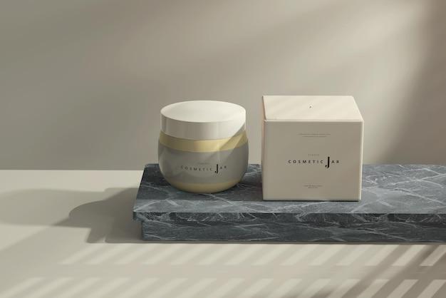 Frasco cosmético e maquete da caixa no tabuleiro de mármore escuro