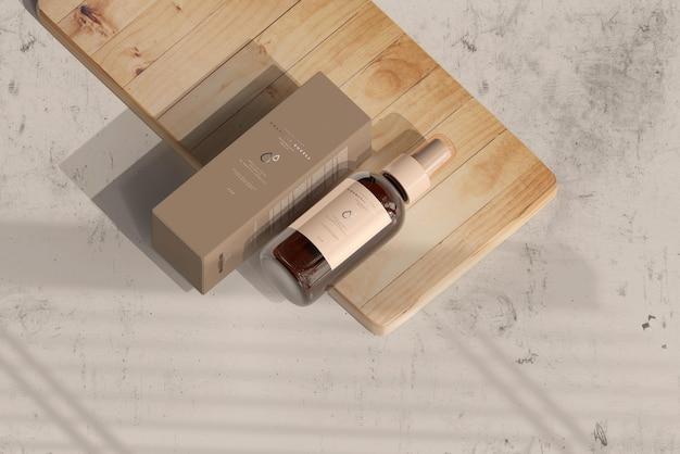 Frasco de spray cosmético de vidro âmbar com caixa de maquete