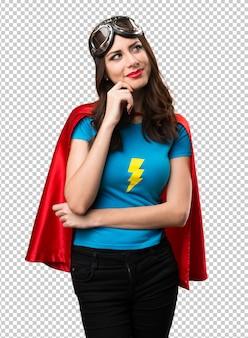 Garota muito super-herói pensando