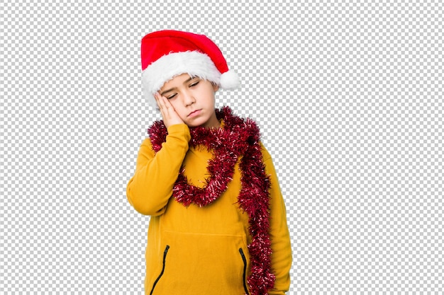 Garotinho, comemorando o dia de natal, usando um chapéu de papai noel isolado que está entediado, cansado e precisa de um dia de relaxamento.