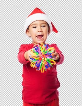 Garoto garoto comemorando o natal