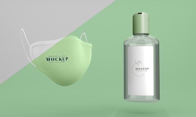 Garrafa de mock-up de desinfetante para as mãos e máscara facial