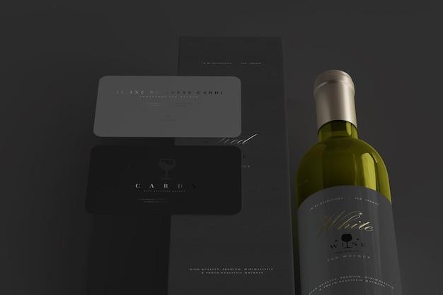 Garrafa de vinho branco com maquete de caixa e cartão de visita