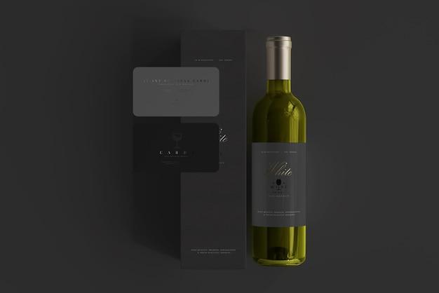 Garrafa de vinho branco com maquete de caixa e cartões de visita