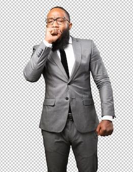 Gesto de sono do homem negro de negócios