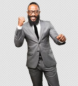 Gesto do vencedor do homem negro do negócio