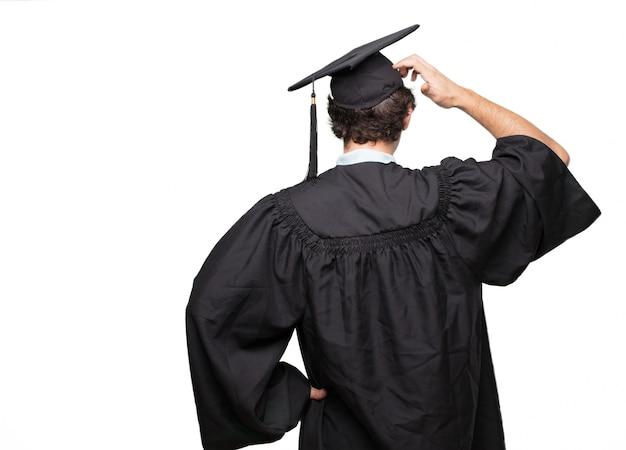 Graduado, homem barbudo, vista traseira, passe quadril, apontar, com, outro, mão, para, um, objeto, à distância