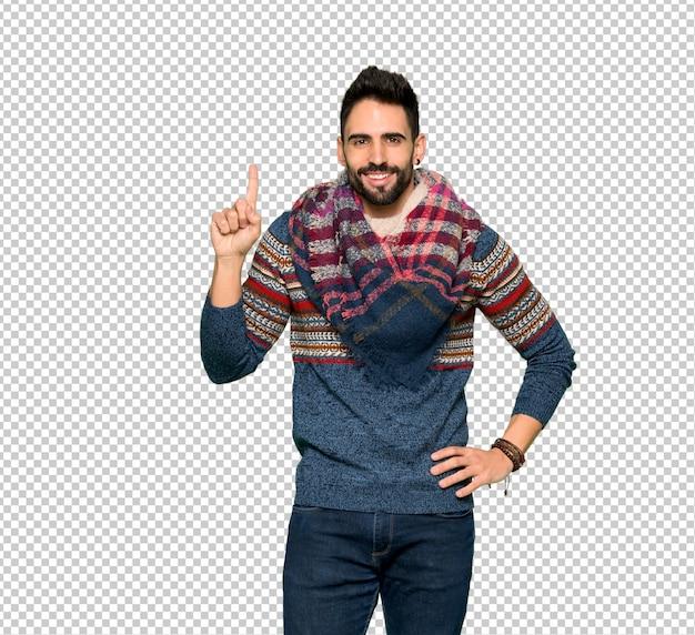 Hippie homem mostrando e levantando um dedo no sinal dos melhores