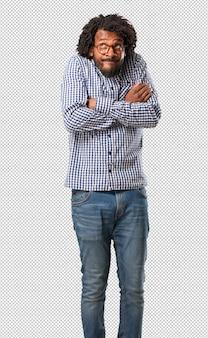 Homem afro-americano de negócios bonito duvidar e encolher os ombros os ombros, conceito de indecisão e insegurança, incerto sobre algo