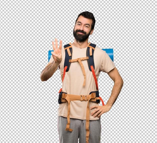 Homem alpinista feliz e contando três com os dedos