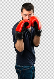 Homem bonito com barba com luvas de boxe