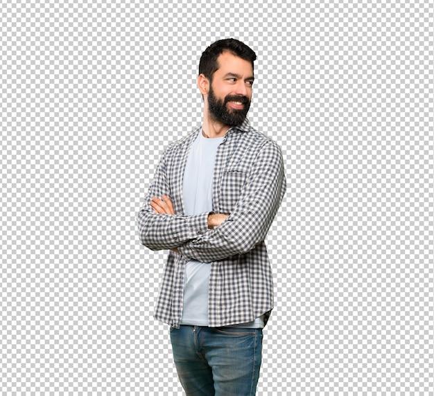 Homem bonito com barba com os braços cruzados e feliz
