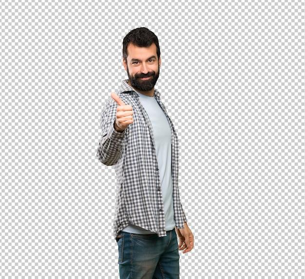 Homem bonito com barba com polegares para cima porque algo bom aconteceu