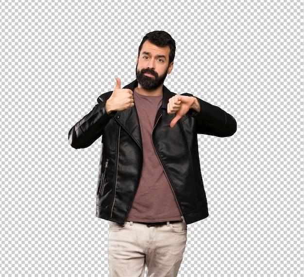 Homem bonito com barba fazendo bom sinal ruim. indeciso entre sim ou não