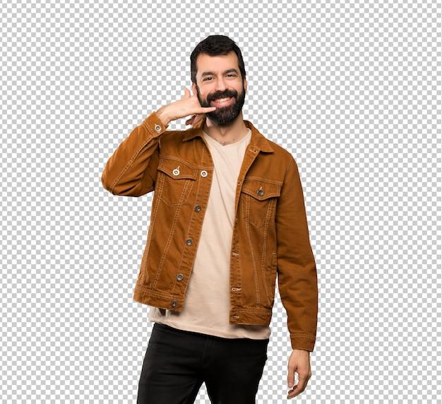Homem bonito com barba, fazendo gesto de telefone. ligue para mim de volta