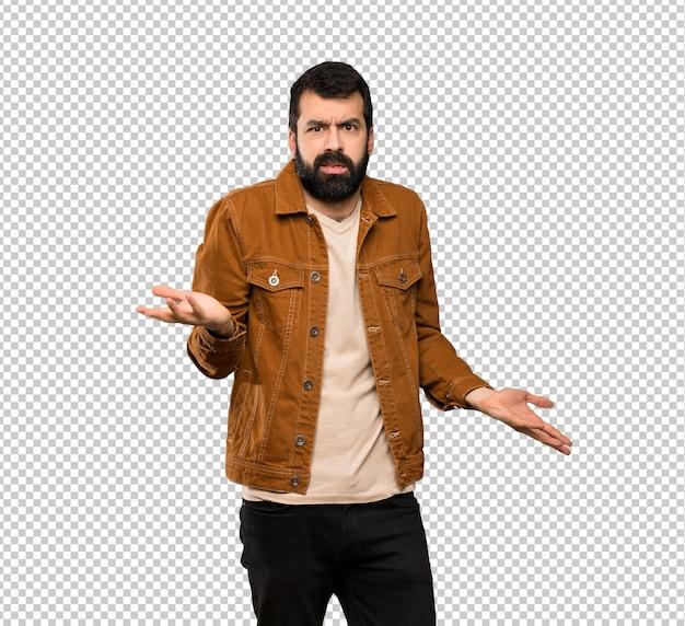 Homem bonito com barba infeliz por não entender algo