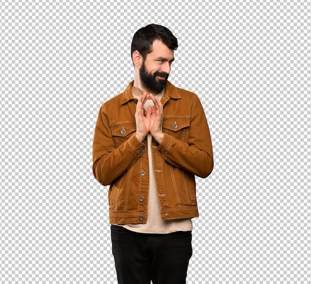 Homem bonito com barba planejando algo