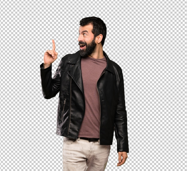 Homem bonito com barba, pretendendo realizar a solução enquanto levanta um dedo