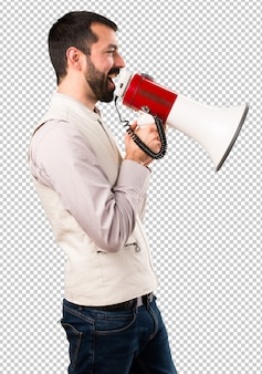 Homem bonito com colete segurando um megafone
