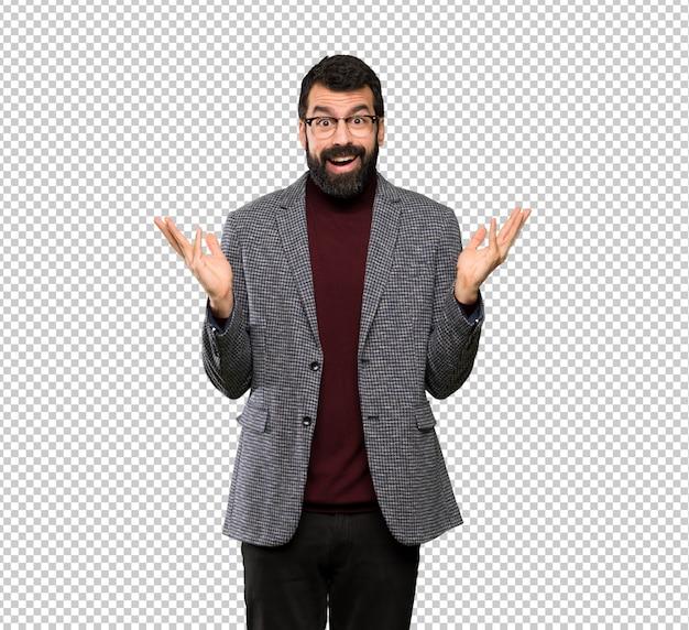 Homem bonito com óculos com expressão facial chocado