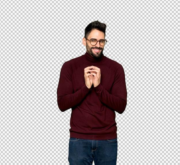 Homem bonito com óculos planejando algo