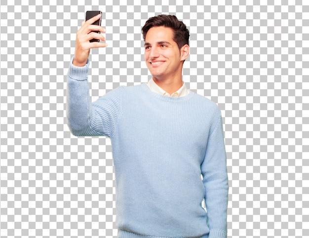 Homem bronzeado bonito jovem com um telefone de tela de toque inteligente