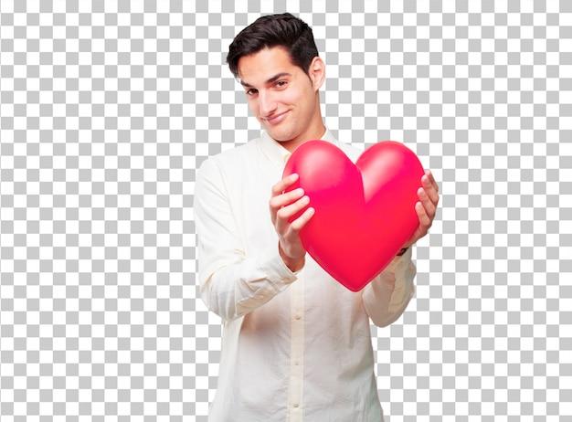 Homem bronzeado considerável novo com uma forma do coração. conceito de amor
