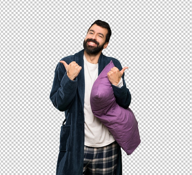 Homem com barba de pijama com polegares para cima gesto e sorrindo