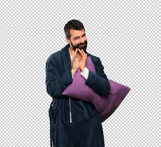 Homem com barba de pijama, planejando algo