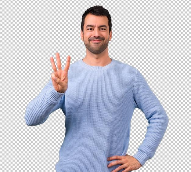 Homem com camisola azul, contando com três dedos