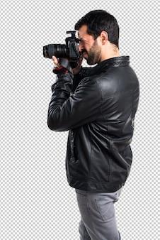 Homem, com, jaqueta couro, fotografar