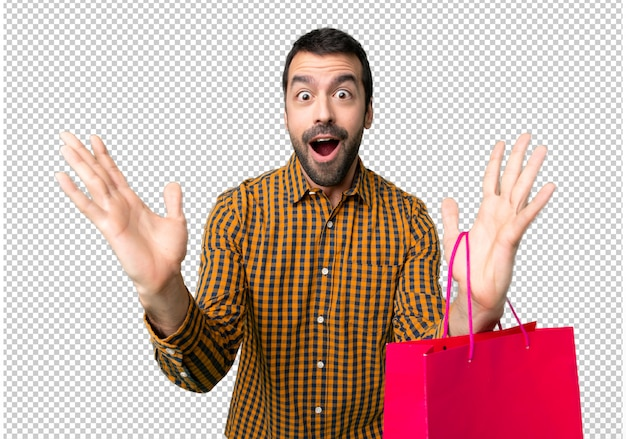 Homem com sacos de compras com surpresa e expressão facial chocada