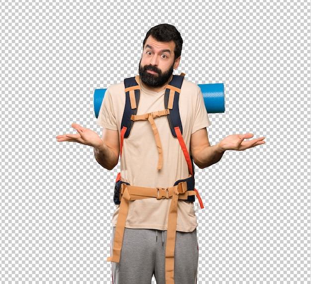 Homem de alpinista a fazer gestos de dúvidas
