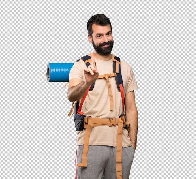 Homem de alpinista mostrando e levantando um dedo
