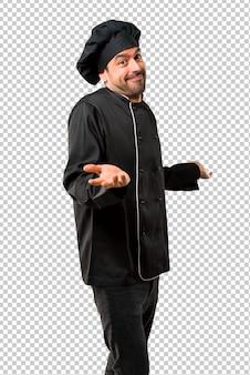 Homem de chef de uniforme preto, tornando sem importância e duvida gesto