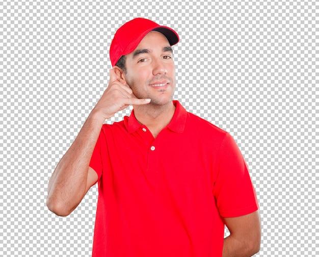 Homem de entrega feliz usando sua mão como um celular
