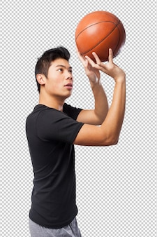 Homem de esporte chinês feliz com bola de basquete