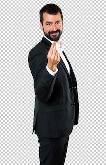 Homem de negócios bonito fazendo gesto de dinheiro