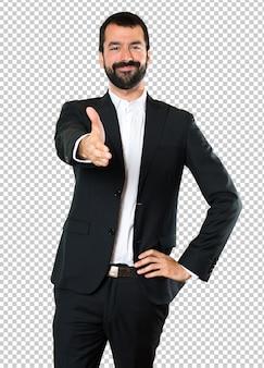 Homem de negócios bonito fazendo um acordo