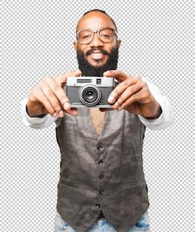 Homem de negócios preto com uma câmera