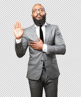 Homem de negócios preto jurando