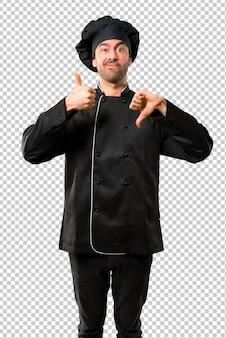 Homem do cozinheiro chefe no uniforme preto que faz o sinal bom-mau. pessoa indecisa entre sim ou não