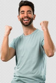 Homem jovem, celebrando, um, sucesso