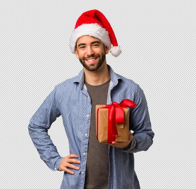 Homem jovem, desgastar, chapéu santa, com, mãos quadrils