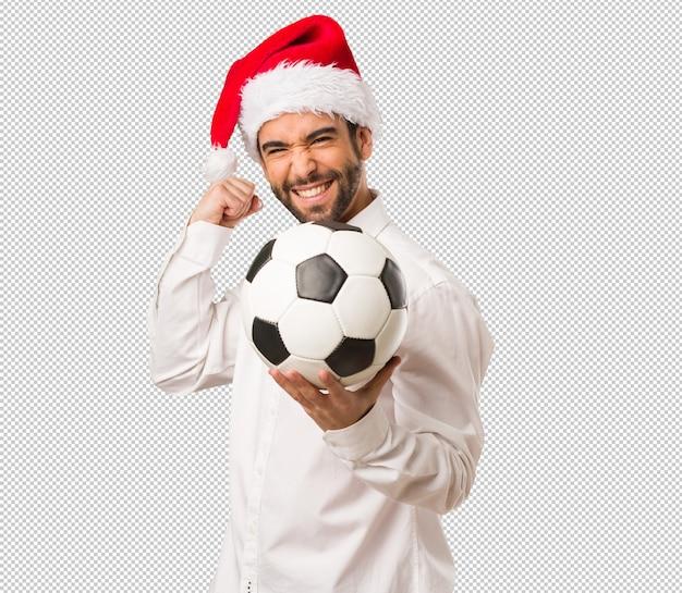 Homem jovem, desgastar, um, papai noel, chapéu, ligado, dia natal
