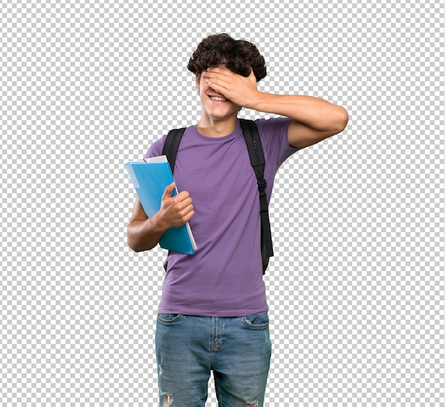 Homem jovem estudante cobrindo os olhos pelas mãos