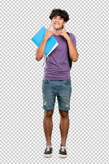 Homem jovem estudante sorrindo com uma expressão feliz e agradável