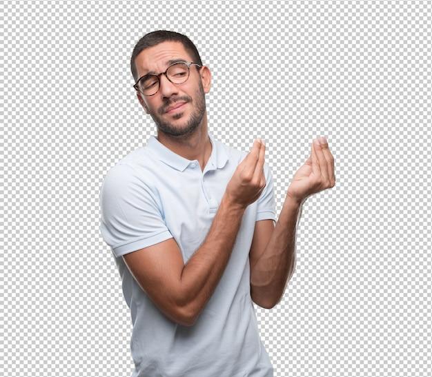 Homem jovem intrigado, fazendo um gesto de não entender