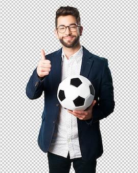 Homem jovem, segurando, um, bola futebol