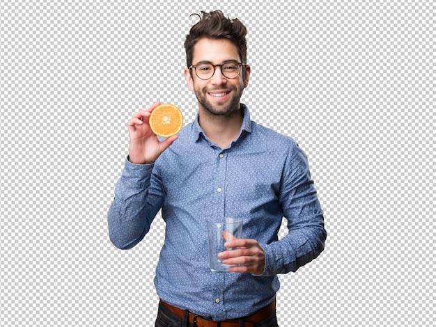 Homem jovem, segurando, um, laranja, e, um, vidro